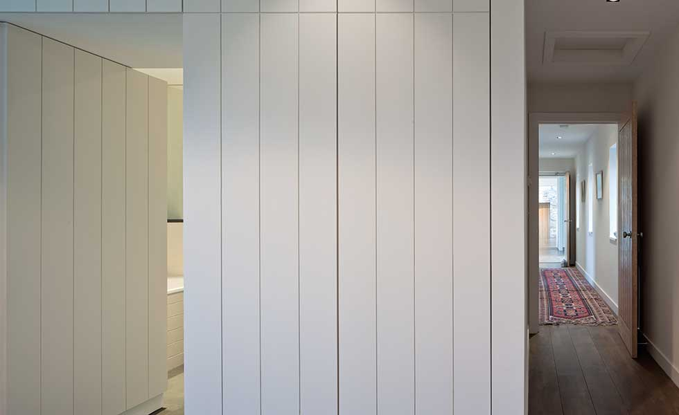 clad white walls of the bedroom