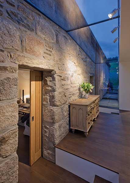 stone hallway with glazed ceiling