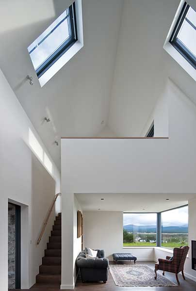 vaulted ceiling in living space with mezzanine