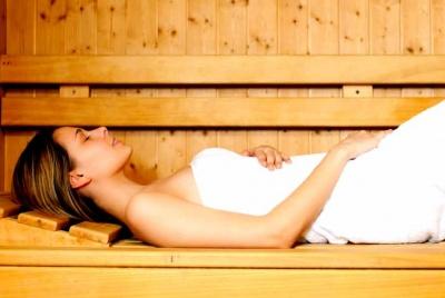 aqua steam room spa lady lying down white towel