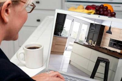 brooklyn kitchens bespoke lady at laptop