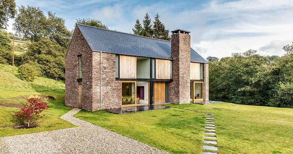 9 homes built with stone homebuilding renovating for Contemporary timber homes