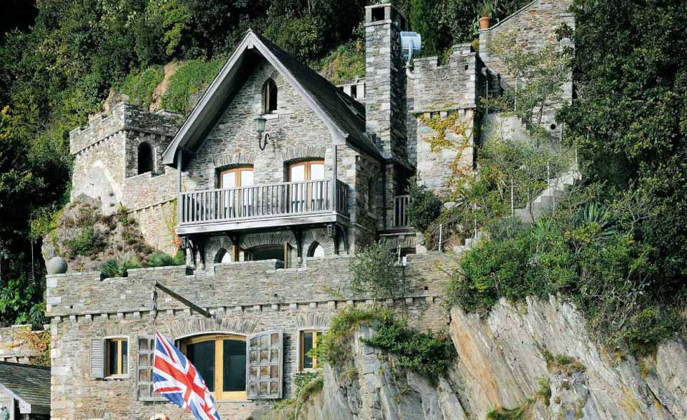 stone cliff face boathouse