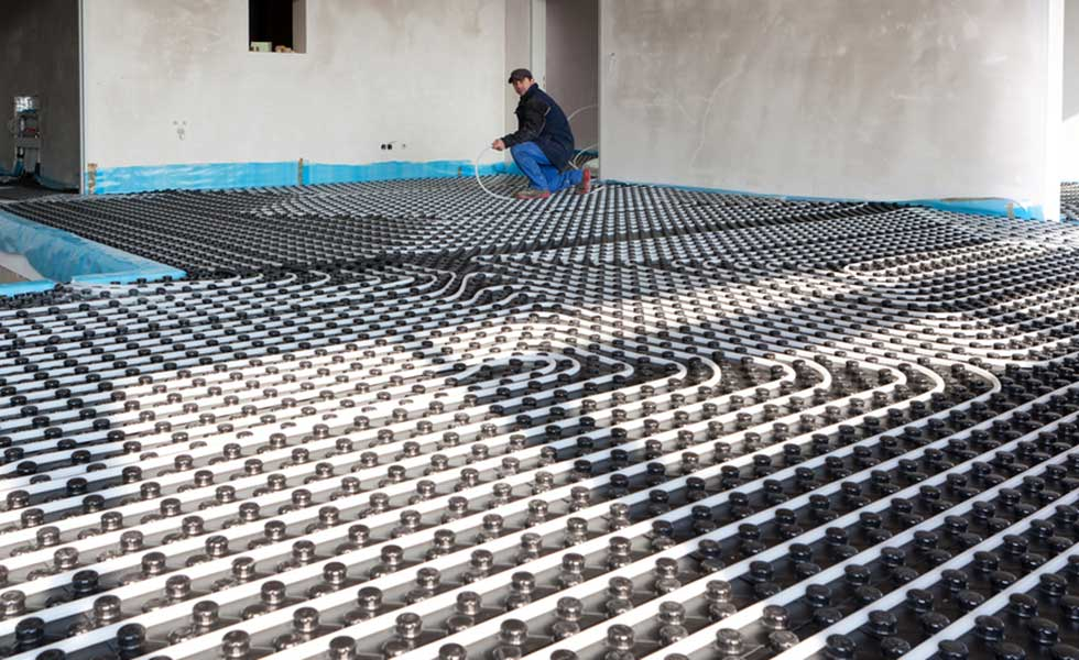 Man fitting underfloor heating
