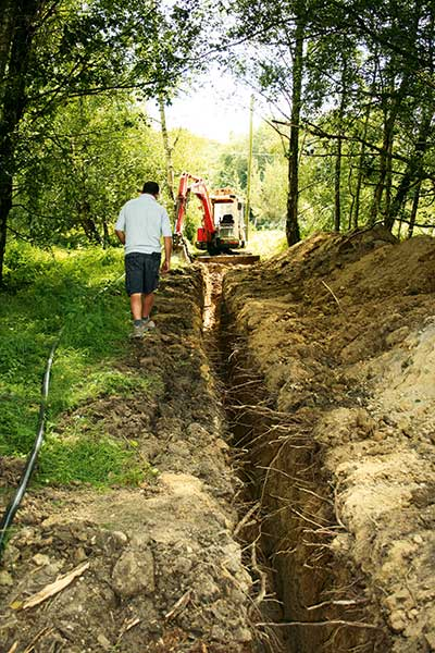 The tradesmen dig out the trenches ready to bring utility services to David and Bruce's self build projects