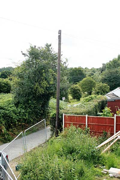 The telegraph pole is moved to David Snell's front garden on the corner of the self build plot