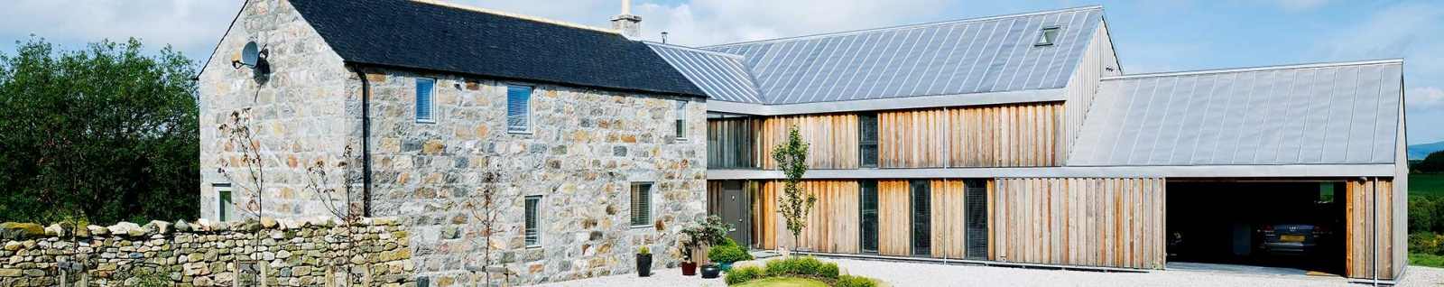 stone farmhouse with timber clad extension