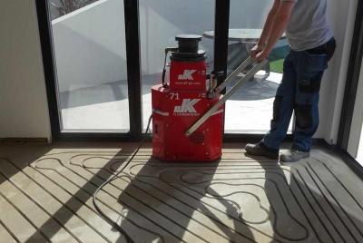 jk floorheating piping laid beachhouse man machine red