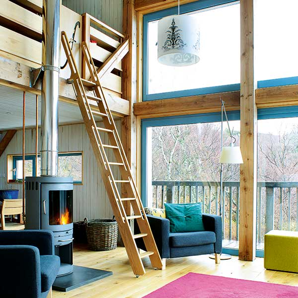 Double-height-living-room-with-large-areas-of-glazing
