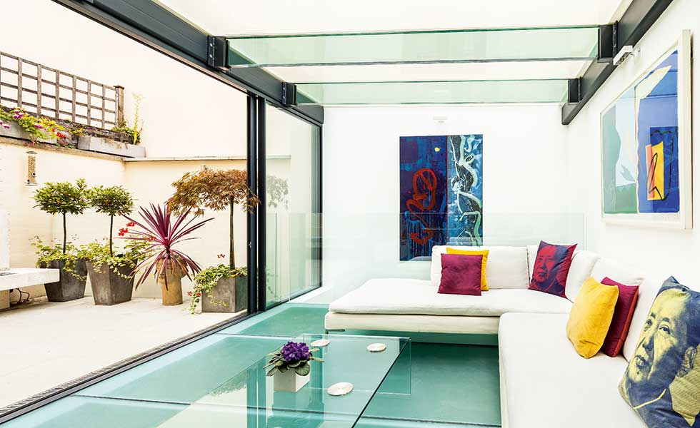 glass basement extension to a Grade II-Listed mews home