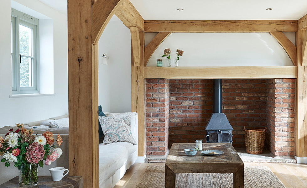 budget-oak-frame-home-living-room-with-woodburner-and-beams