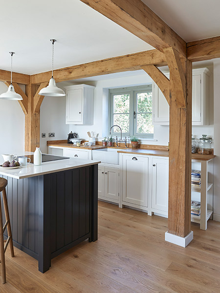 budget-oak-frame-home-kitchen-with-dark-blue-island