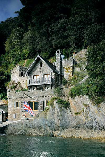A stone self build on the coast is built to look like an old ruin