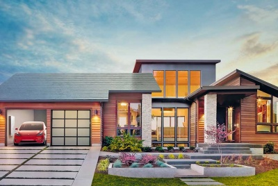 House with solar tiles, Tesla Powerwall 2 and electric vehicle