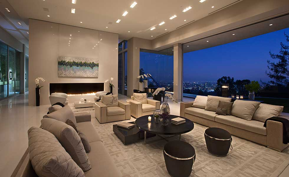A large open plan living space overlooking the city of Los Angeles at night