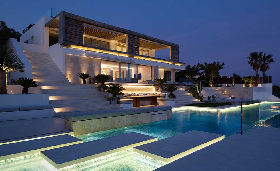 Perfect for New Year, this SAOTA designed contemporary villa in Ibiza is lit up at night
