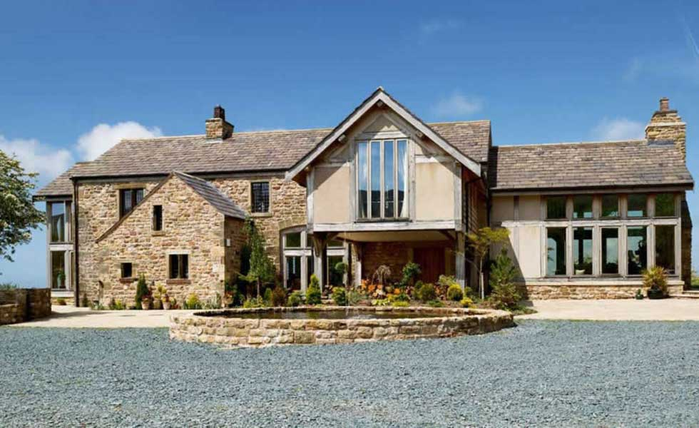 stone barn conversion with oak frame extensions