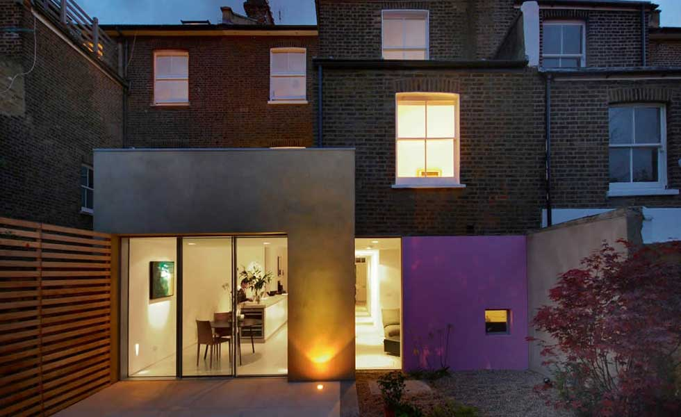 vibrant and modern pink concrete extension to Victorian terrace