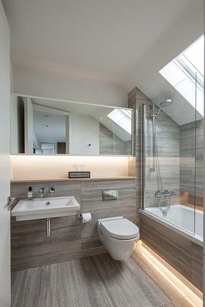 grey bathroom with sloping ceiling