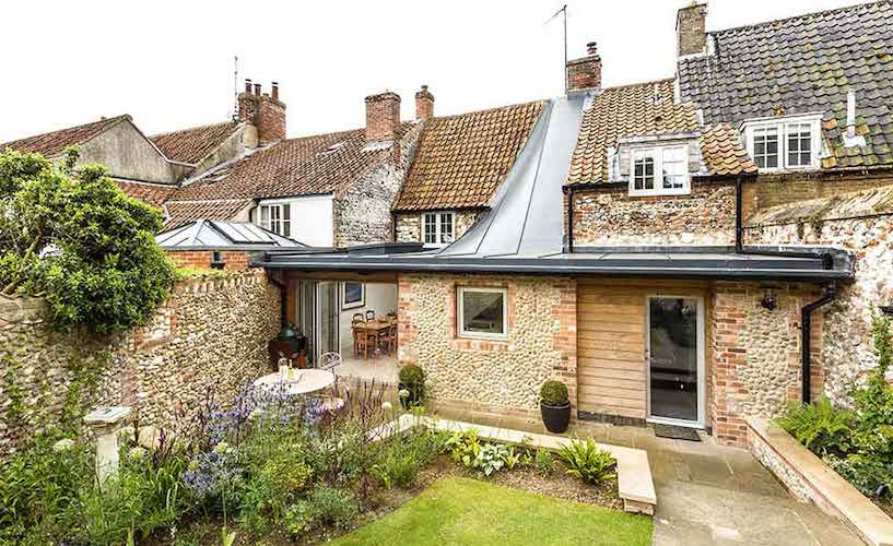 Rear exterior of extended grade II listed cottage