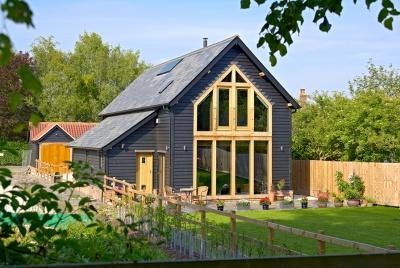 Oakwrights An Oak-framed barn style home