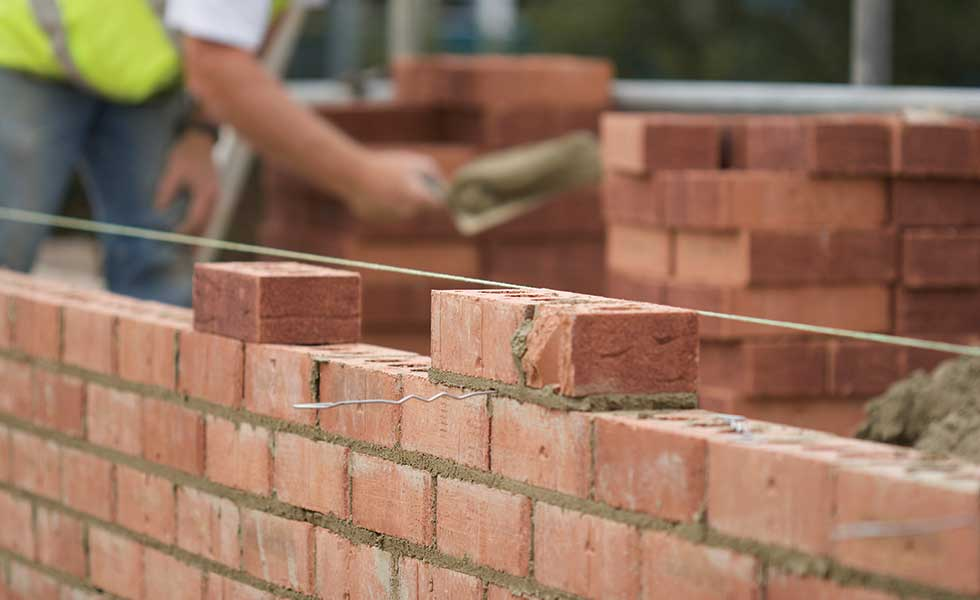 Comparing wall system costs homebuilding renovating for Brick house construction cost
