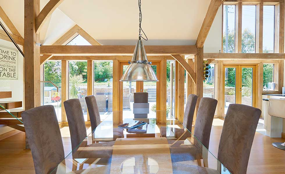 Dining room with exposed timber beams and French doors