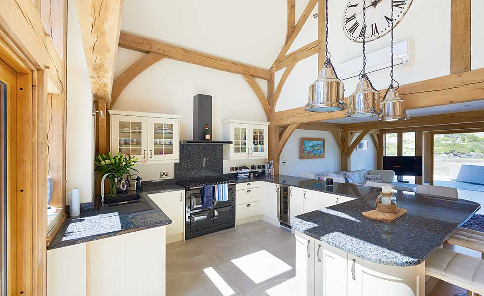 Double height kitchen with exposed oak frame