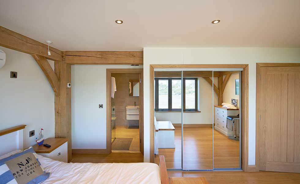 Master bedroom with en suite and exposed timber frame