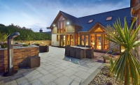 Contemporary oak frame house with timber cladding and render