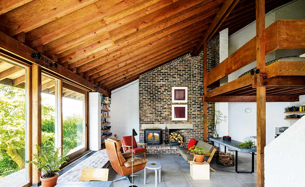 A considered palette of raw materials creates a midcentury modern feel in this living space
