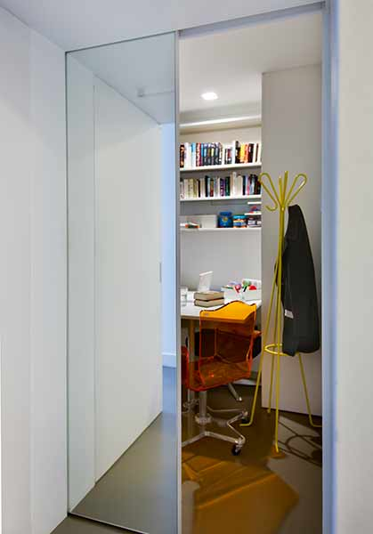 A hidden door reveals a secret office space in this London home