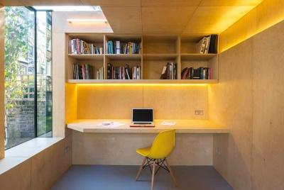 Layered LED lighting illuminates this garden home office