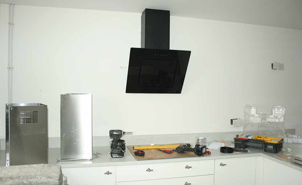 The cooker hood is fitted during the fixtures and fittings stage of David Snell's self build