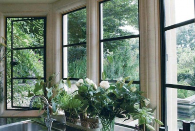 Architectural bronze casements flowers in window