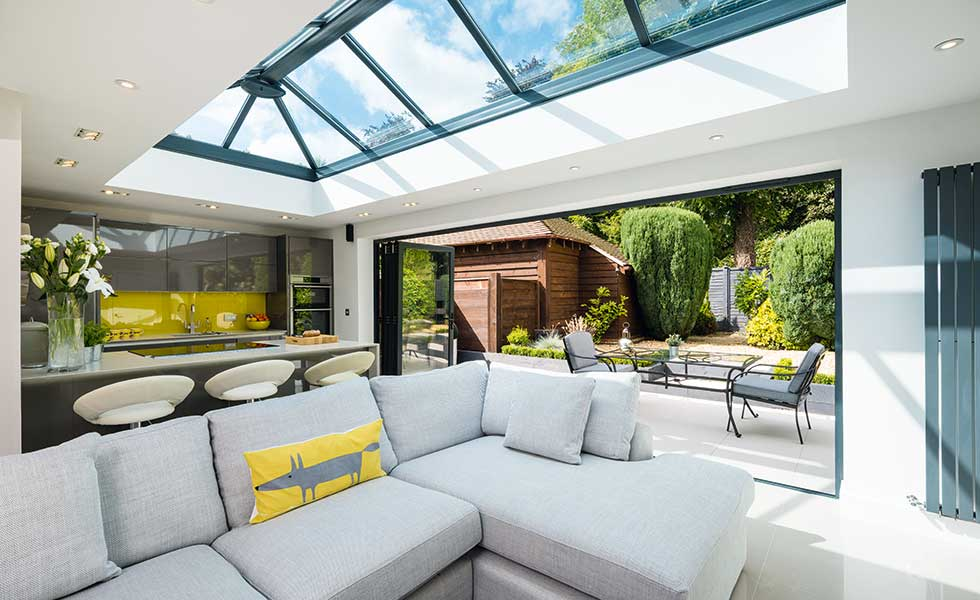 Open plan dining living space with roof lantern
