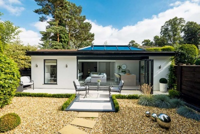 Contemporary garage conversion with bi-fold doors to the outside