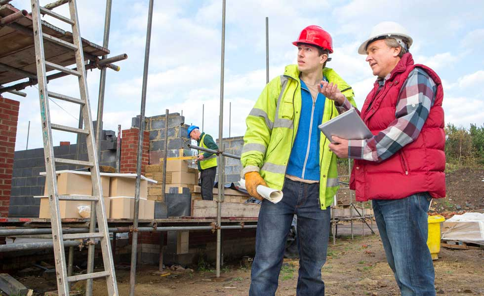 client and builder talking on site
