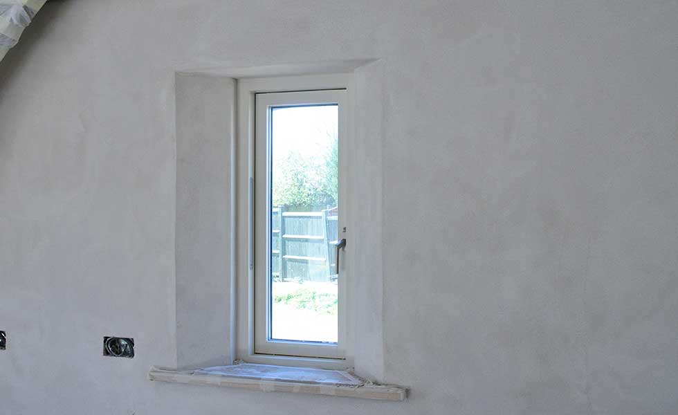 window reveal in a lime plastered hempcrete home