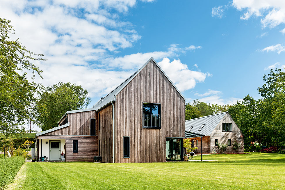 timber clad exterior of a self build package home on a large plot
