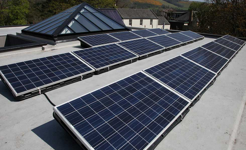 renew green energy Solar Pv on a flat roof