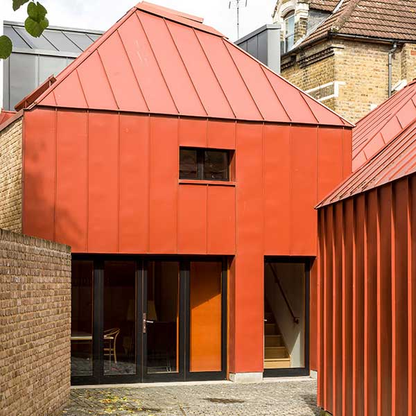 square orange contemporary home made from metal