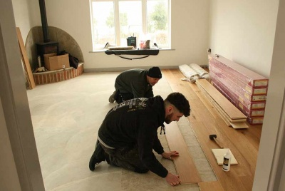 Before moving in, the trades get to work laying the flooring in David's self build