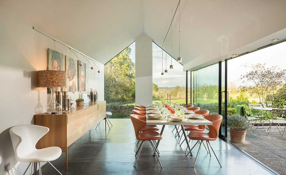 dining room with vaulted ceiling from August 2017 issue cover