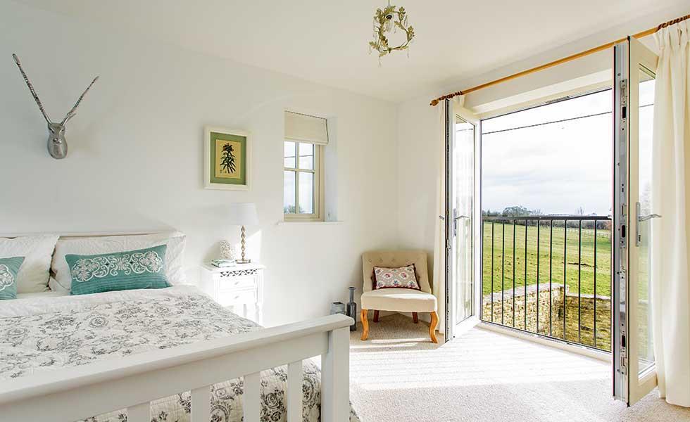 12 design ideas for your master suite homebuilding for Bedroom balcony design ideas