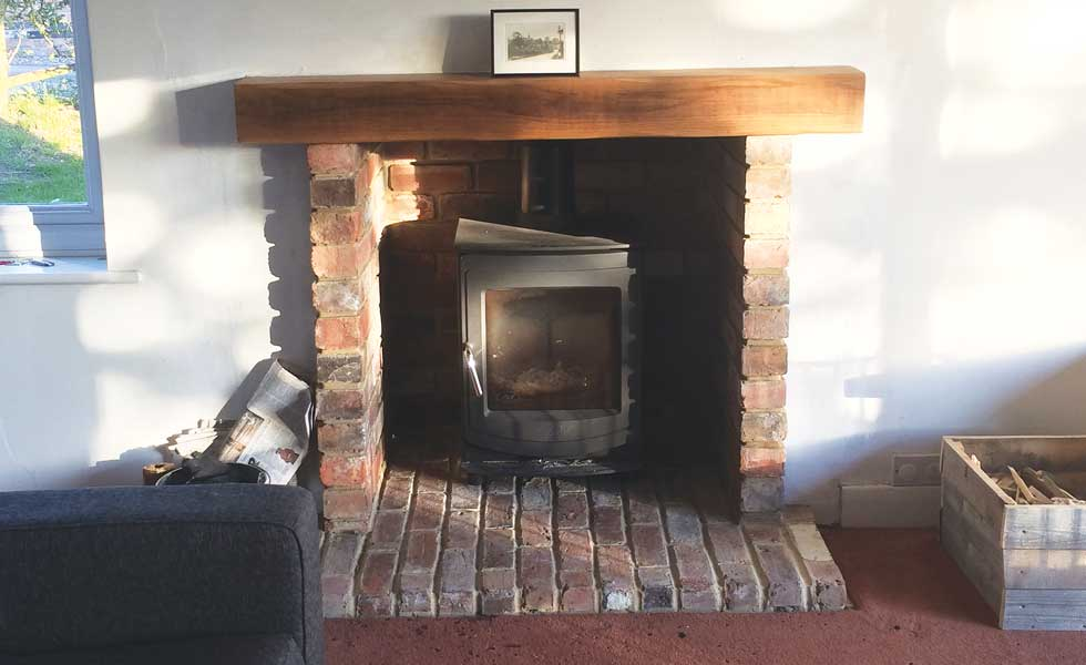 Jason opted for a more energy efficient woodburning stove