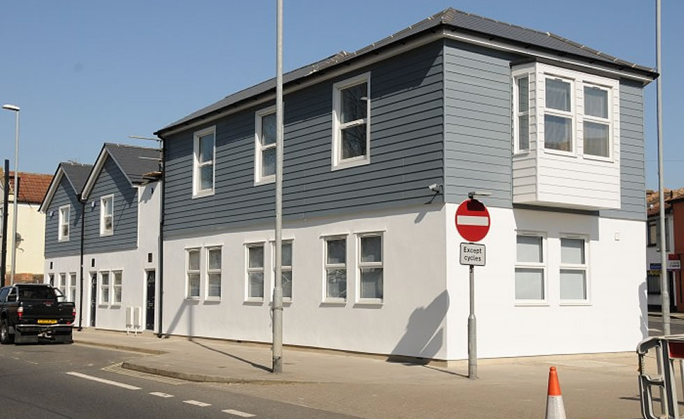 Weatherboard cladding range in Colonial Blue and White used for South Hants Property Service development