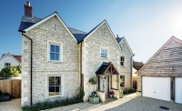 This Cotswold stone-clad self build in Wiltshire was built using package company Potton
