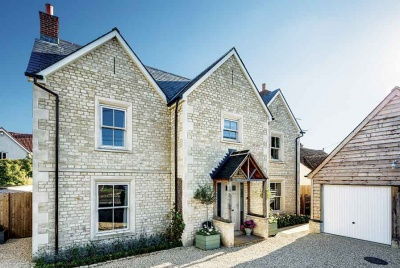 This Cotswold stone-clad timber frame self build in Wiltshire was built using package company Potton