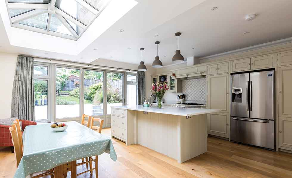 The new extension by Design Squared made way for a new kitchen diner lit from above by a roof lantern as well as bi-fold doors
